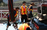 stunt crew setting up for a bungee jumping stunt