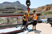 stunt crew setting up safety gear for a major professional bungee stunt