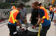professional bungee stunt crew attaching bungee cords to strong base