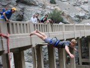 photo of person doing a superman front dive off of the bridge to nowhere bungee jump location