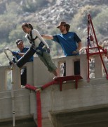 photo of woman and two instructors doing a forward lumber jack bungee jump on a bungee jump adventure in southern california