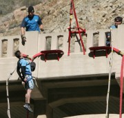 photo of man and instructor beginning an elevator drop bungee jump from the bridge to nowhere in Asuza California